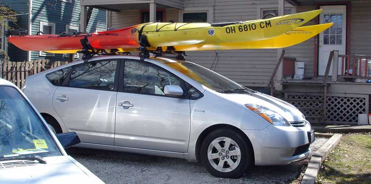 Prius with kayaks on the roof.